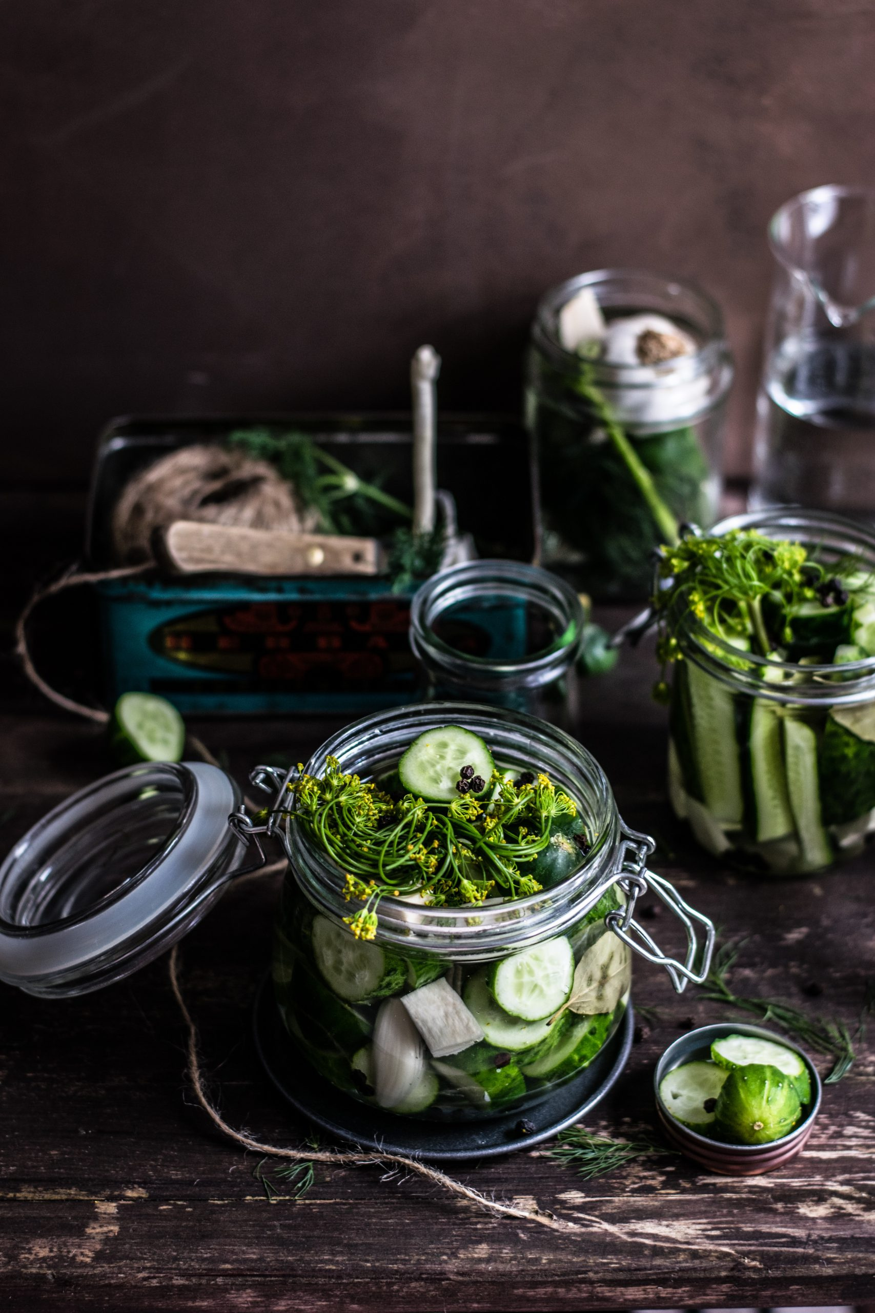 Homemade pickles and dill in glass jar