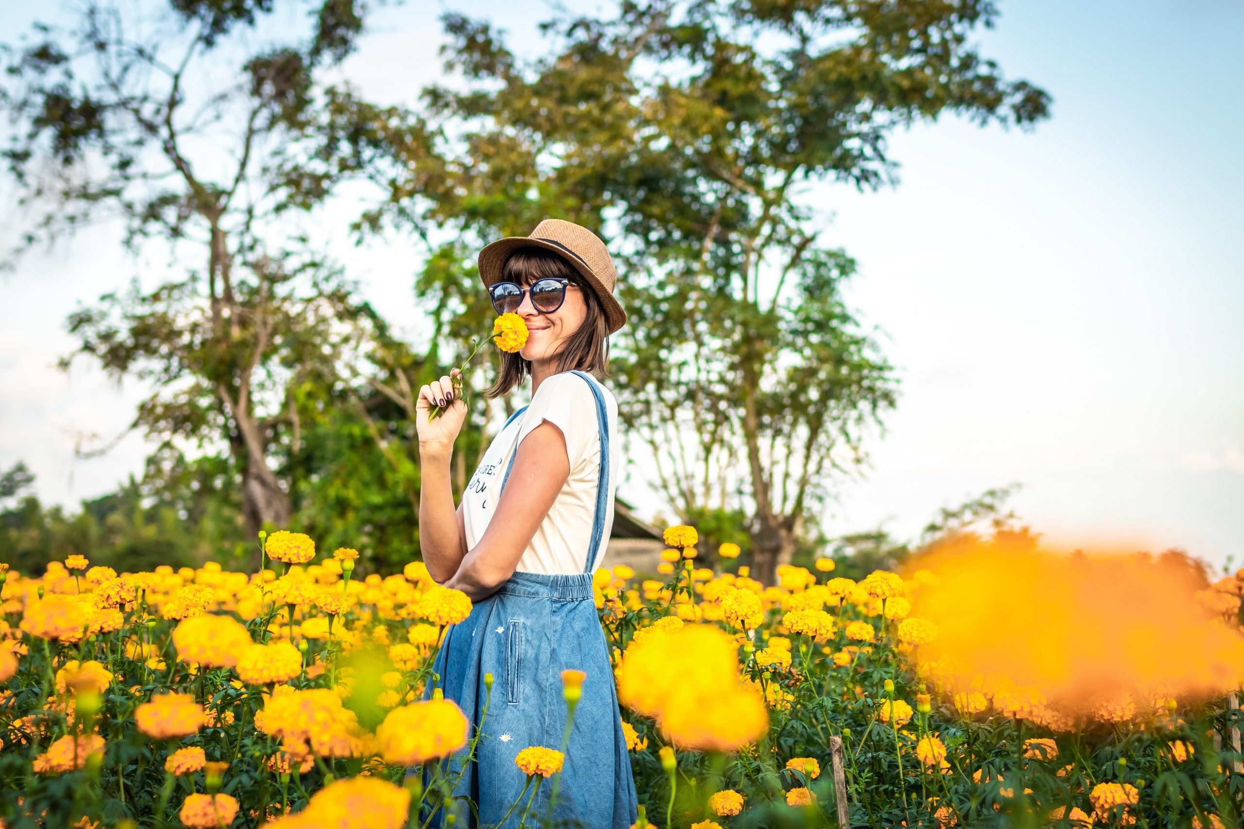 Woman smiling in field of flowers